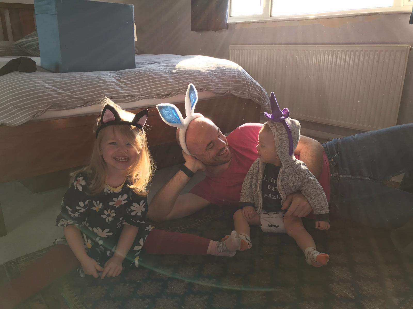 Photo of family wearing bunny ears